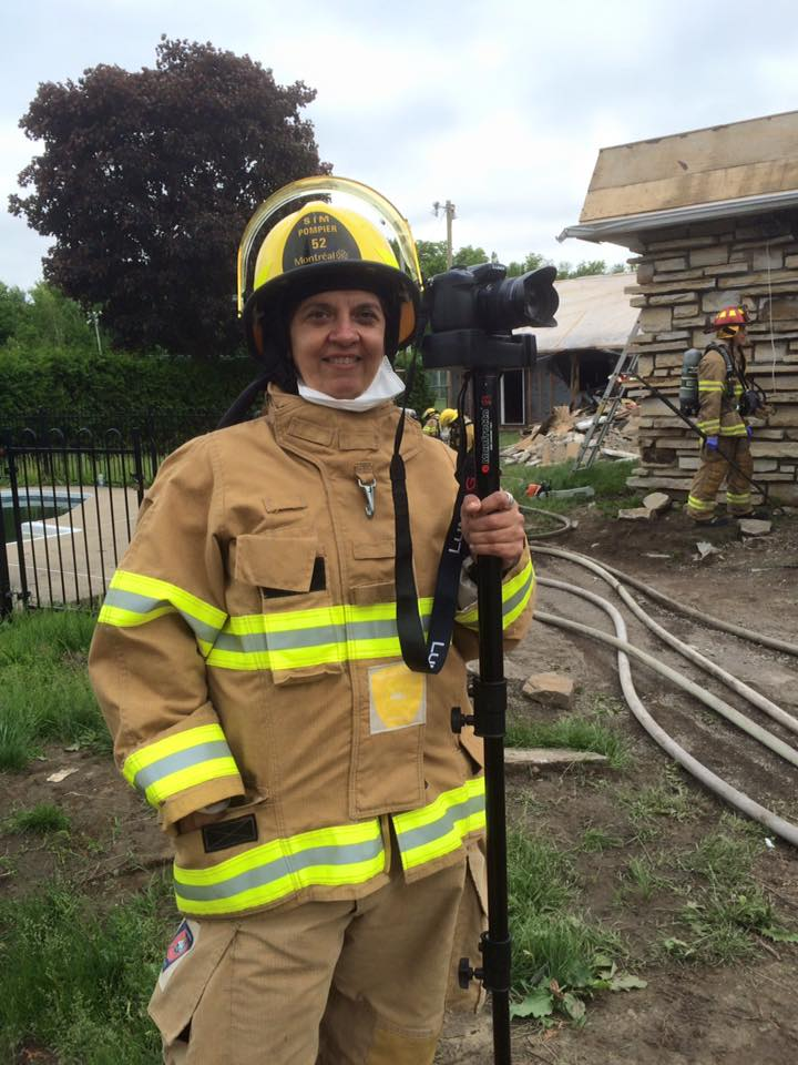 A female firefighter with a video camera