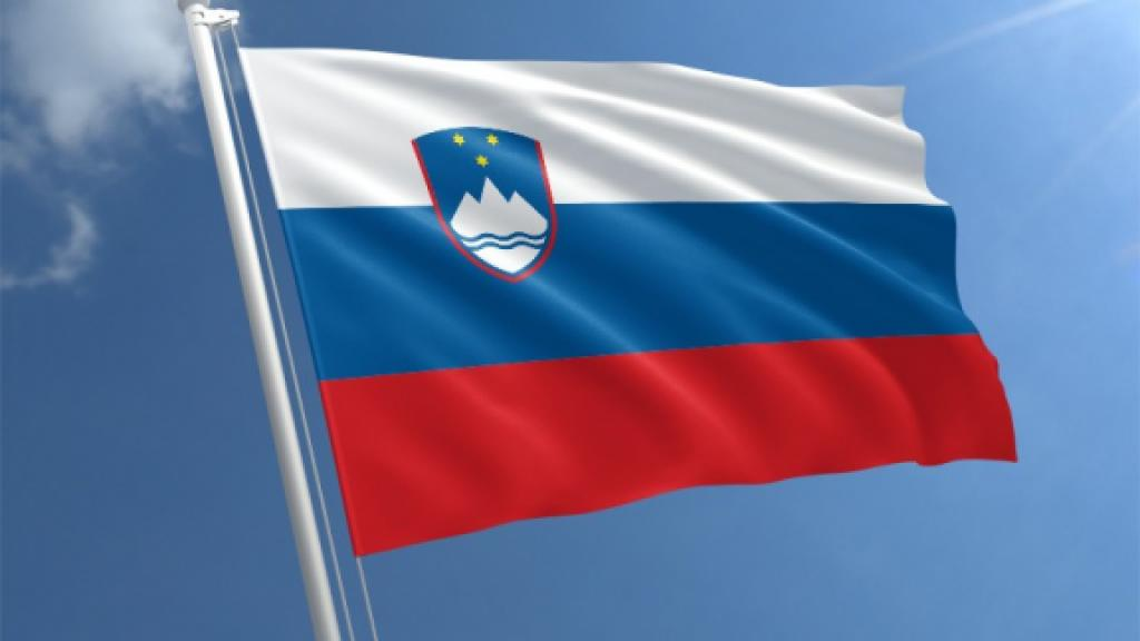 Slovenian flag against a blue sky